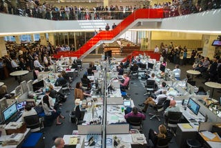 The New York Times celebrates foreign correspondent Alissa J. Rubin's Pulitzer Prize as executive editor Dean Baquet and the newsroom look on last April. (Angel Franco/New York Times)