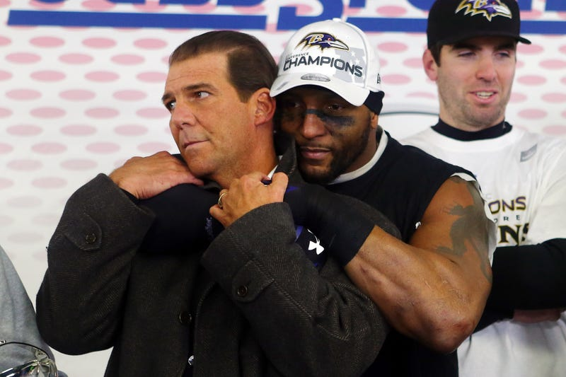 Ray Lewis of the Baltimore Ravens (center) celebrates with owner Steve Bisciotti in the locker room after defeating the New England Patriots in the 2013 AFC Championship game Jan. 20, 2013, in Foxboro, Mass. (Elsa/Getty Images)