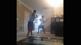Image from video of Tavis Sellers boxing with his teenage sonFacebook screenshot
