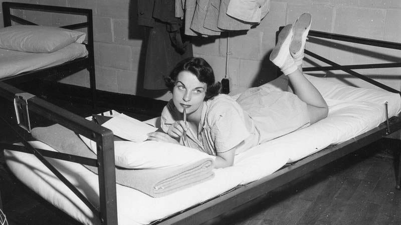 Marine Private Doris Gates writes a letter in her barracks, Parris Island, South Carolina, 1951 (Photo: PhotoQuest/Getty Images)