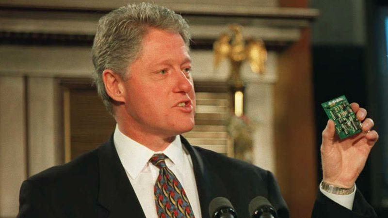 Bill Clinton explains the V-Chip, one of the act's provisions, at a press conference in 1996. (Photo: Paul J. Richards/AFP/Getty Images)