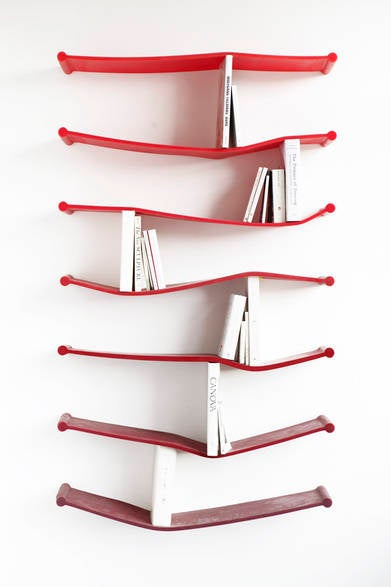 Illustration for article titled Bendy Rubber Bookshelves Literally Accommodate Whatever Literary Tastes You Have On Hand