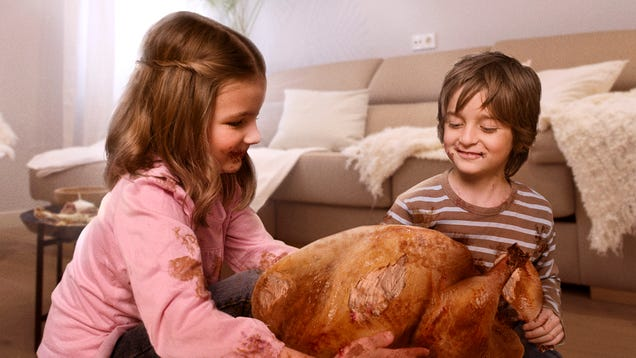Parents Allow Excited Children To Tear Open One Turkey For Thanksgiving Eve