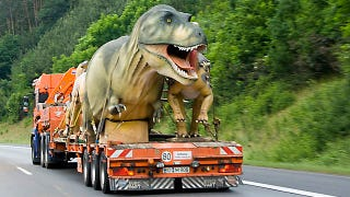 Illustration for article titled Tyrannosaurus on a truck might be the scariest thing you'll see on your commute