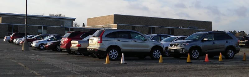 Illustration for article titled One of these poll worker's cars is not like the others