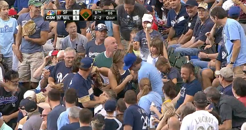 Illustration for article titled One Triumphant Little Girl Emerges Out Of A Foul Ball Frenzy