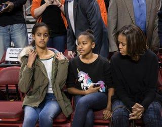 Malia Obama, Sasha Obama and Michelle ObamaBRENDAN SMIALOWSKI/AFP/Getty Images