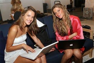 Illustration for article titled Victoria's Secret Models Like MacBooks Too!