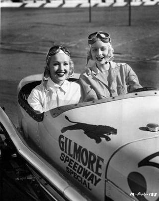Illustration for article titled Betty Grable and Lucille Ball in a Racecar