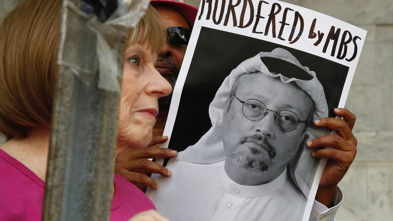 People hold signs during a protest at the Embassy of Saudi Arabia in Washington on October 9, 2018