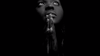 """An image from the video for Alicia Keys' song """"We Gotta Pray""""YouTube Screenshot"""