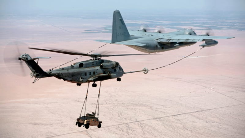 Illustration for article titled This Is A Plane That's Refueling A Helicopter That's Carrying A Hummer