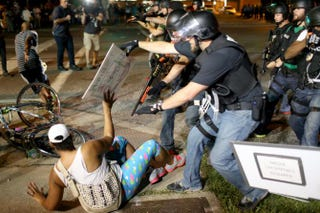 Police officers arrest a demonstrator on Aug. 18, 2014, in Ferguson, Mo.Joe Raedle/Getty Images