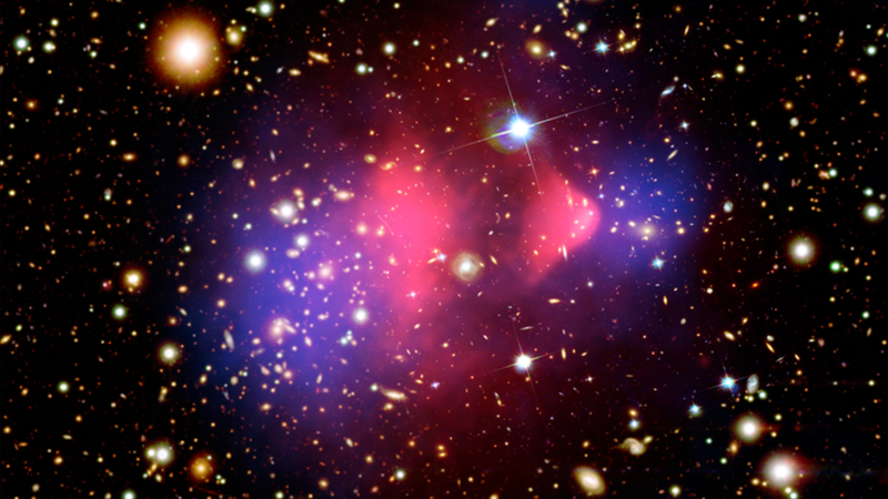 The Bullet Cluster Image: X-ray: NASA/CXC/CfA/M.Markevitch et al.; Optical: NASA/STScI; Magellan/U.Arizona/D.Clowe et al.; Lensing Map: NASA/STScI; ESO WFI; Magellan/U.Arizona/D.Clowe et al.