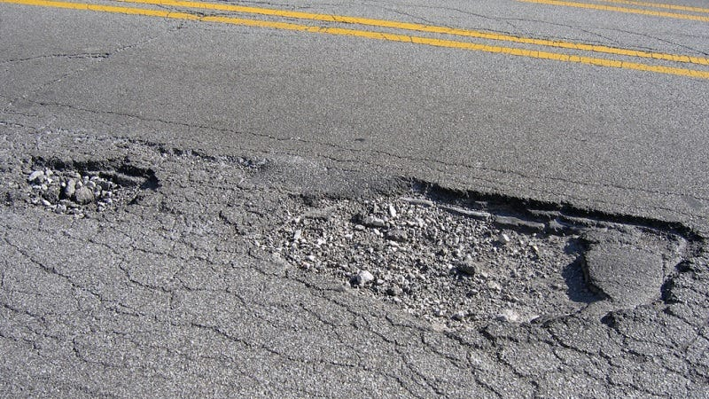 Illustration for article titled Drive Over Potholes Straight On If You Can't Avoid Them