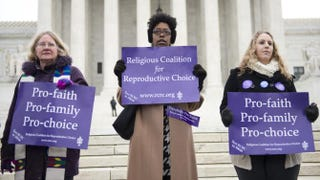 Pro-choice demonstrators stand outside the U.S. Supreme Court following oral arguments in the case of McCullen v. Coakley on Jan. 15, 2014.Saul Loeb/Getty Images