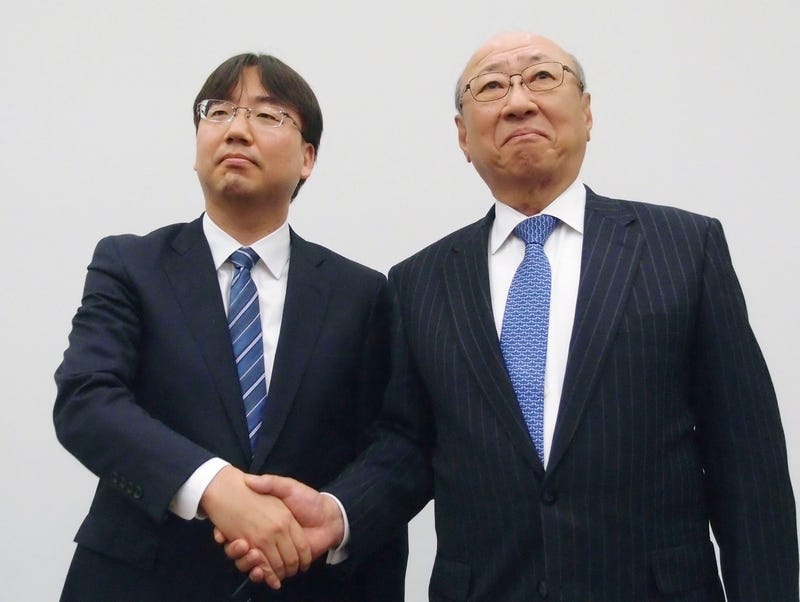 Nintendo's next president Shuntaro Furukawa (left) shakes hands with current president Tatsumi Kimishima in Osaka on April 26.