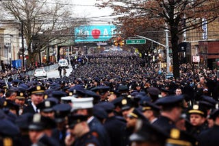 Police officers from across the country attend a funeral service for slain New York City Police Officer Wenjian Liu Jan. 4, 2015, in the Brooklyn borough of New York City. Officers Wenjian Liu and Rafael Ramos were killed in an ambush while sitting in their patrol car Dec. 20, 2014.Spencer Platt/Getty Images