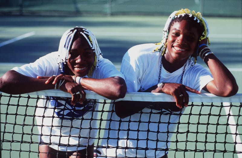 16 Jan 1998: Teenage tennis sisters from America, Venus (left) and Serena Williams take time off a practise session to pose together during the Adidas International event at White City in Sydney, Australia.