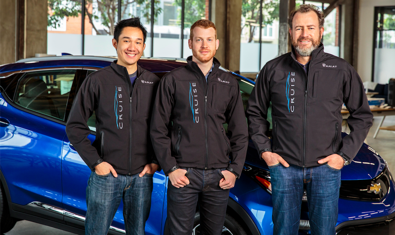 GM President Dan Ammann (the older guy) standing in front of a Chevy Bolt with Cruise Automation co-founders Kyle Vogt and Daniel Kan. Photo: GM
