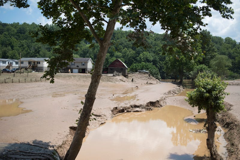 Farmland and crops are covered by mud from the flooding of the Elk River June 25, 2016, in Falling Rock, W. Va. The flooding of the Elk River claimed the lives of at least 24 people in West Virginia. Ty Wright/Getty Images