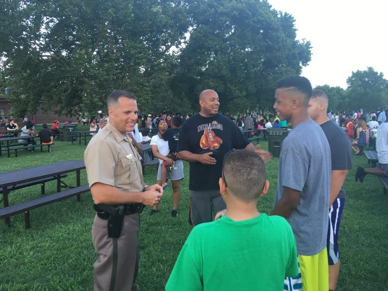 An officer talks to community members at a community cookout in Wichita, Kan., on July 19, 2016, that replaced a protest.Wichita, Kan., Police Department via Facebook