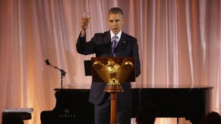 President Barack Obama raises a glass and toasts his guests during a dinner on the occasion of the U.S.-Africa Leaders Summit on the South Lawn of the White House Aug. 5, 2014, in Washington, D.C.Chip Somodevilla/Getty Images