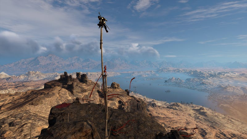 A very high vantage spot in Assassin's Creed Origins, a game that was in development while at least three other Assassin's Creeds were also being built.