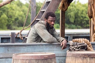 Noah (Aldis Hodge) leaning over the side of a boat in UndergroundWGN