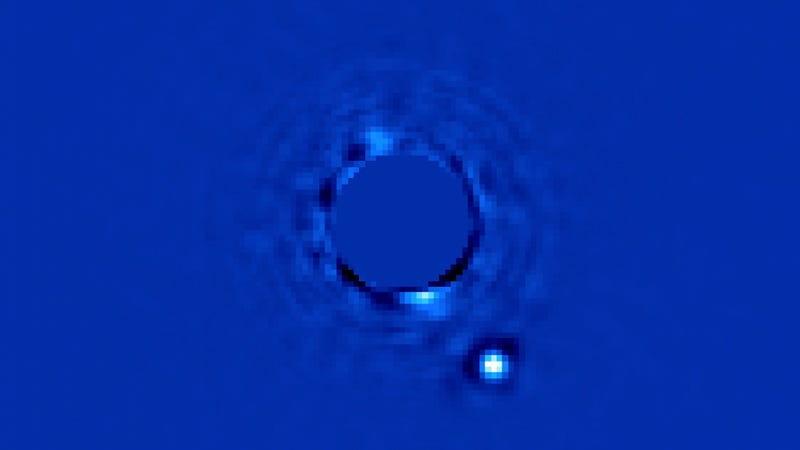 Illustration for article titled Powerful new planet finder snaps a direct image of an exoplanet