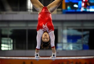 Illustration for article titled Gymnast Performs A Hair-Raising Routine