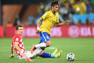 Neymar of Brazil dribbles past Ivan Perisic of Croatia in the first half during the 2014 FIFA World Cup Brazil Group A match between Brazil and Croatia at Arena de Sao Paulo June 12, 2014, in Sao Paulo.Buda Mendes/Getty Images