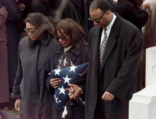 Alma Brown (center), the widow of Secretary of Commerce Ron Brown, and her children, Tracey and William, leave Arlington National Cemetery in Virginia on April 10, 1996, following the graveside ceremony for Ron Brown, who was killed April 3 in a jet crash near Dubrovnic, Croatia.LUKE FRAZZA/AFP/Getty Images