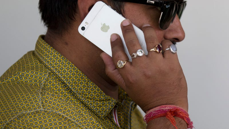 An Indian man talks on his iPhone in New Delhi in May 2016.