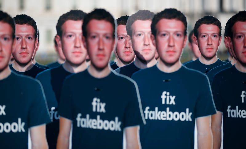 "Life-sized cutouts of Facebook CEO Mark Zuckerberg wearing ""Fix Fakebook"" t-shirts are displayed by advocacy group, Avaaz, in Washington DC on April 10, 2018."