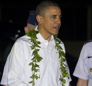 President Obama wears a traditional Hawaiian lei.