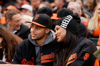 Stephen Curry of the Golden State Warriors and his wife, AyeshaLachlan Cunningham/Getty Images