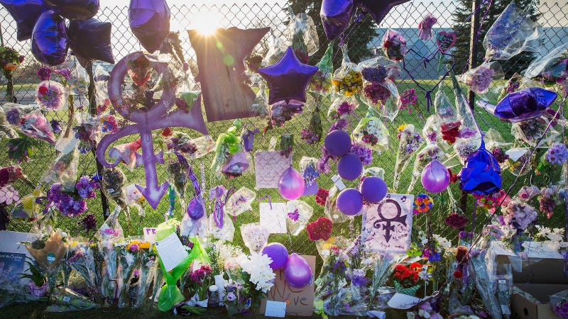 Image of the fence that surrounds Paisley Park, via Getty