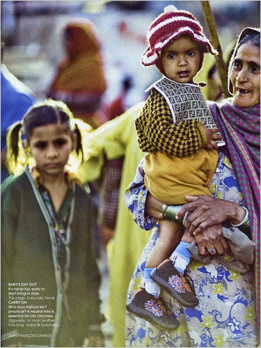 Illustration for article titled Vogue India Puts Fendi Bib On Impoverished Child; Critics Freak