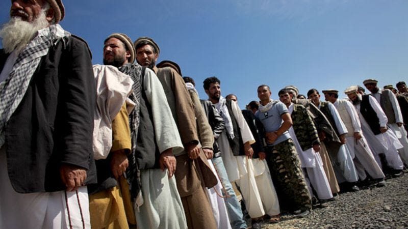 Afghan citizens line up to vote in, sabotage, or just observe August's presidential election.