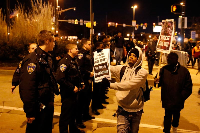 Protesters confront Baltimore police officers as they march through the streets after a mistrial was declared in the trial of Baltimore Police Officer William G. Porter, for the death of Freddie Gray, on Dec. 16, 2015, in Baltimore. (Rob Carr/Getty Images)
