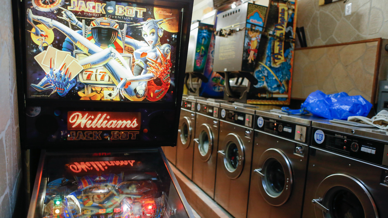 Illustration for article titled An Incredible Pinball Bar Is Hidden Behind This Laundromat