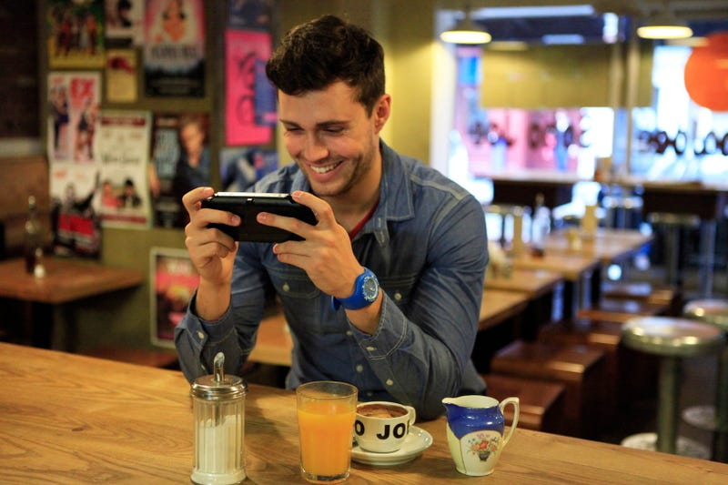 Illustration for article titled Attractive Young Men Smiling at the PlayStation Vita