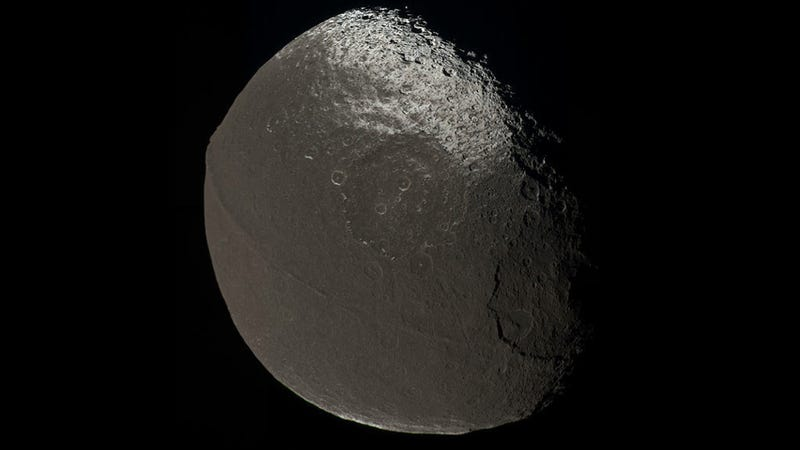 Illustration for article titled Astronomers say Saturn's moon Iapetus may have once had a mini-moon all its own