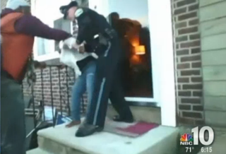 Michael Gaymon begs a police officer not to arrest his daughter, Sanshuray Purnell, in Collingdale, Pa., Feb. 22.NBC 10