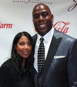 NBA Hall of Famer Magic Johnson and wife Cookie attend the 2014 Steve & Marjorie Harvey Foundation Gala at the Hilton Chicago on May 3, 2014 in Chicago.Photo by Tasos Katopodis/Getty Images