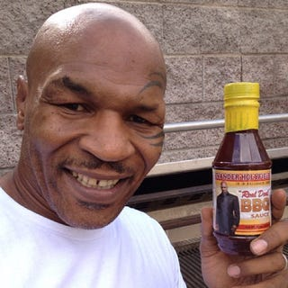 Illustration for article titled Mike Tyson: Evander Holyfield's Barbecue Sauce Is Ear-Licking Good