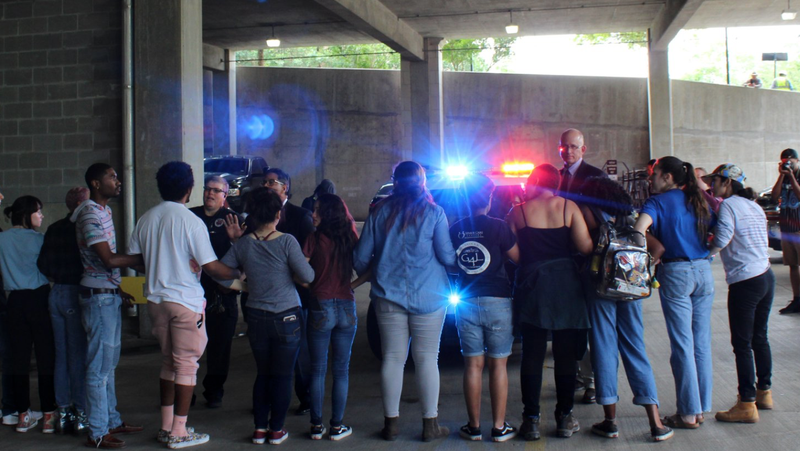 Students try to prevent Jackie Merritt and other senators from leaving the Matthews St. Garage with police escort on the campus of Texas State University in San Marcos