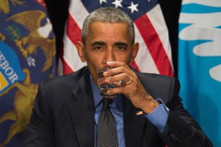President Barack Obama drinks filtered Flint, Mich., water during a meeting at the Food Bank of Eastern Michigan in Flint on May 4, 2016.JIM WATSON/AFP/Getty Images