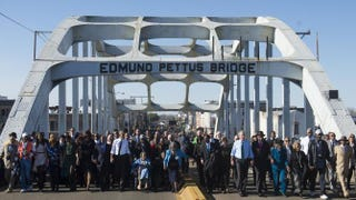 President Barack Obama, first lady Michelle Obama, former President George W. Bush and former first lady Laura Bush, and U.S. Rep. John Lewis (D-Ga.), one of the original marchers, lead a walk across the Edmund Pettus Bridge to mark the 50th anniversary of the Selma-to-Montgomery, Ala., civil rights marches in Selma March 7, 2015.  SAUL LOEB/AFP/Getty Images